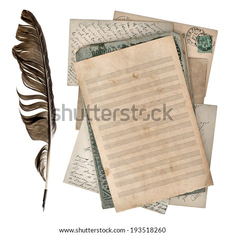 aged paper sheet for musical notes and antique ink pen isolated on white background - stock photo