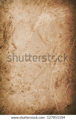 Aged parchment or paper - stock photo