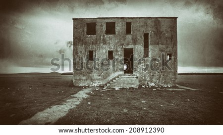 Aged photo of a bleak and scary haunted house - stock photo
