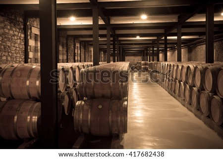 Aged photo of old cellar with many barrels  - stock photo
