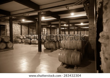 Aged photo of old  winery  with   barrels  - stock photo