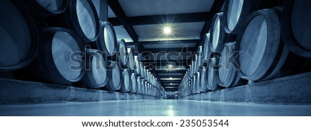 Aged photo of winery with  many  barrels in rows - stock photo