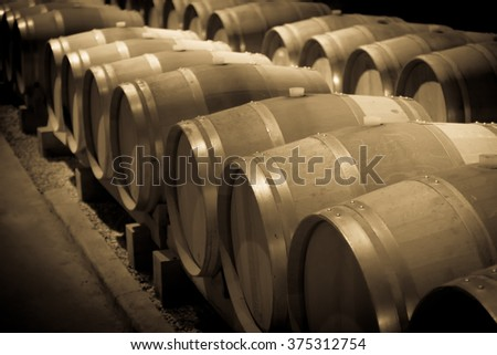 Aged photo of  wooden barrels in french winery   - stock photo