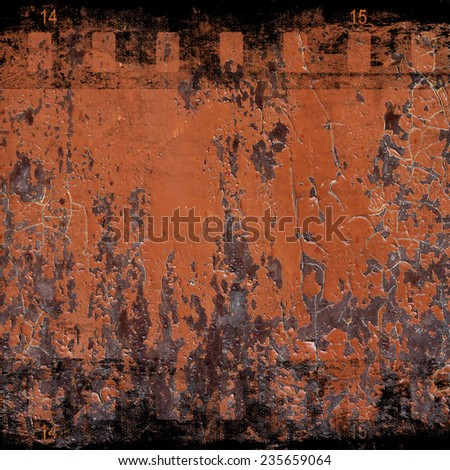 Aged rusted wall with film strip - stock photo