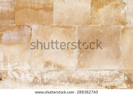 Aged sand stone brick wall background - stock photo
