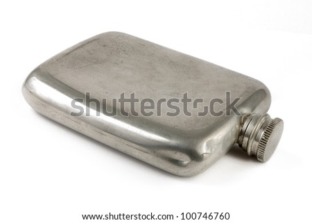 Aged silver hip flask over white