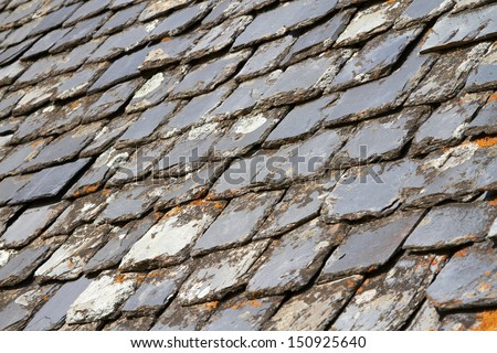 Aged Slate roof tiles close-up - stock photo
