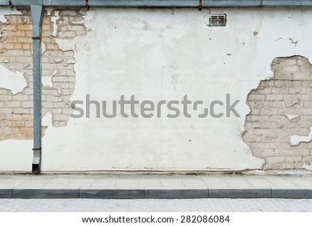 Aged street wall background - stock photo