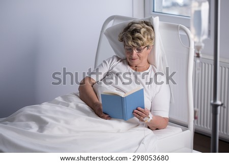 Aged terminally ill woman and her relax time in hospice - stock photo