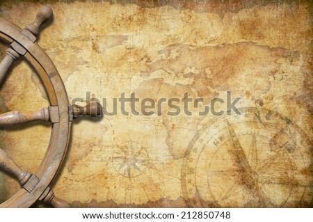 aged treasure map with steering wheel - stock photo