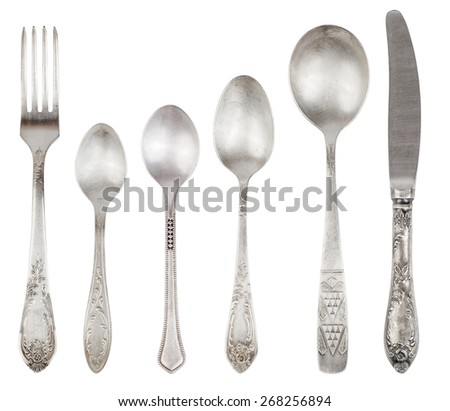 Aged vintage silver cutlery (fork, knife, spoons) isolated on white background.  - stock photo
