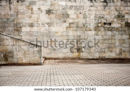 Aged wall with stairs detail - stock photo