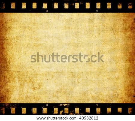 Aged wallpaper with film strip - stock photo