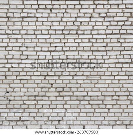 Aged white brick wall seamless texture. - stock photo