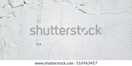 Aged White Brick Wall Wide Texture.  Distressed Whitewash Brickwall Empty Background. Grunge Gray Dirty Stonewall Surface. Dark White Grey Shabby Exterior Worn Wreck Wall. Abstract Horizontal Banner