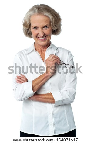 Aged woman in formals holding reading glasses