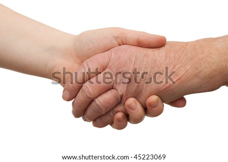 Ageing - handshake between young and old women shaking hands