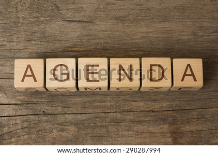 AGENDA text on a wooden background - stock photo