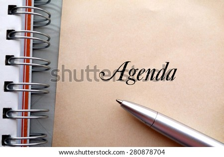 Agenda text write on paper as background with pen and book - stock photo