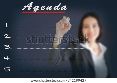 Agenda Woman writing word