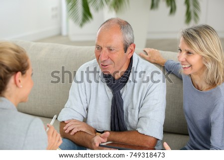agent explaining contract to senior couple