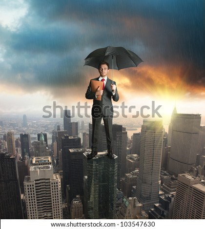 Agent on a skyscraper. Concept of insurance protection
