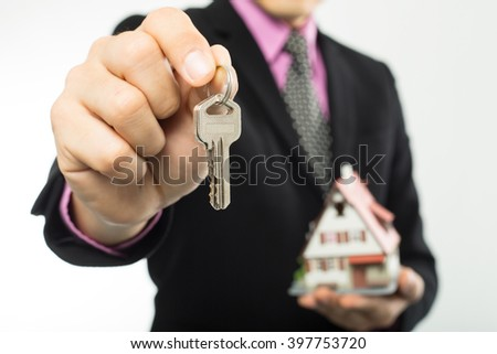 Agent show key real estate to customer . - stock photo