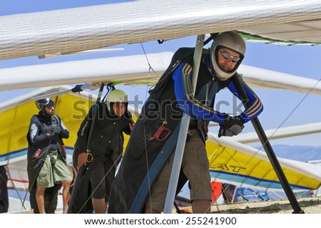 AGER, SPAIN - AUGUST 9, 2013: Ukrainian pilot Oleg Matvieiev waits on his turn to launch during  British Open hanggliding competitions. - stock photo