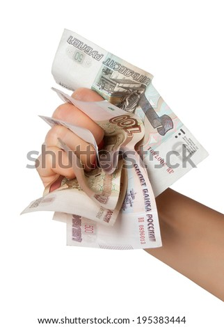 Aggression. Russian money crumpled and trapped in his fist. - stock photo