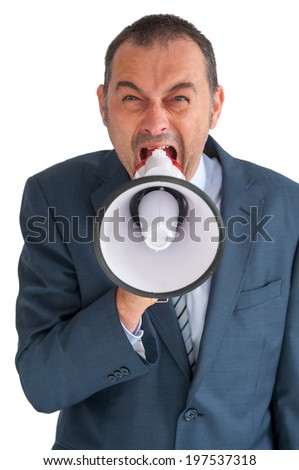 aggressive businessman shouting to camera through a loudhailer - stock photo