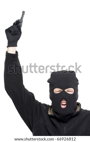Aggressive Crazed Shooter Points A Gun In The Air During A Stickup - stock photo