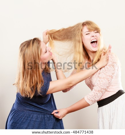 stock photo aggressive women fighting over jealous girls wooing violence