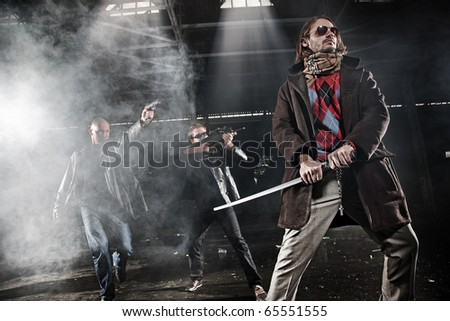 Aggressive men with weapons - stock photo
