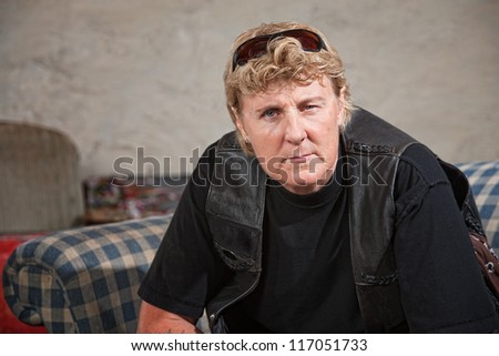 Aggressive white female biker gang member with sunglasses