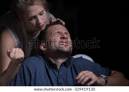 Aggressive woman and domestic violence against husband - stock photo
