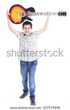 Aggressive young boy playing guitar - stock photo