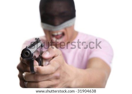 Aggressively adjusted young man having the gun