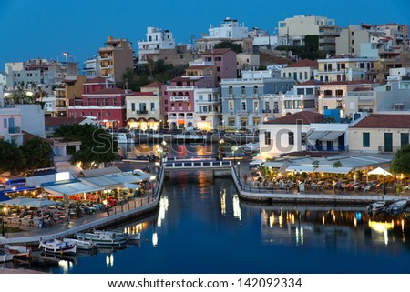Aghios Nikolaos night view - picturesque town in the eastern of island Crete built on the northwest side of the peaceful bay of Mirabello - stock photo