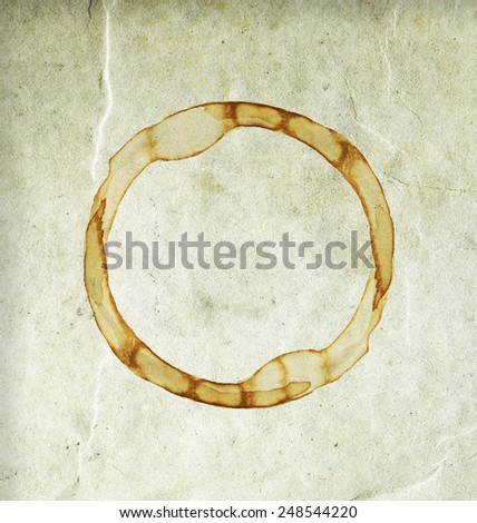 Aging, worn paper with coffee stain. Closeup - stock photo
