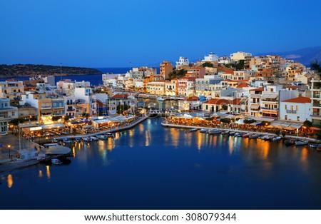 Agios Nikolaos and Voulismeni lake in Crete island, Greece. - stock photo