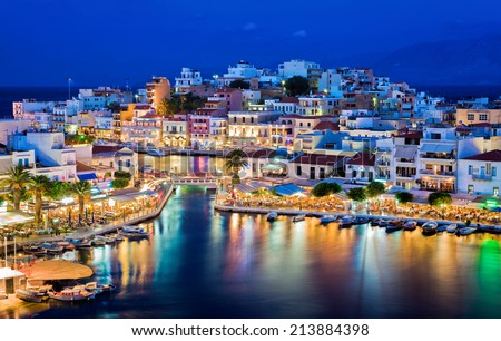 Agios Nikolaos at night. Crete, Greece. Agios Nikolaos is a picturesque town in the eastern part of the island Crete built on the northwest side of the peaceful bay of Mirabello.  - stock photo