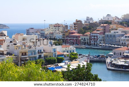 Agios Nikolaos, Crete, Greece. Agios Nikolaos is a picturesque town in the eastern part of the island Crete built on the northwest side of the peaceful bay of Mirabello. - stock photo