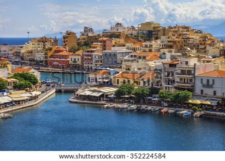 Agios Nikolaos, Crete island, Greece : Boats moored at lagoon of Voulismeni lake