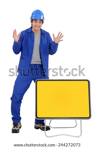 Agitated worker with a blank road sign