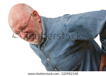 Agonizing Senior Man with Hurting Back on a White Background. - stock photo