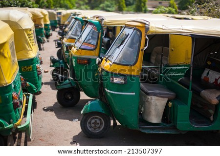 AGRA, INDIA - APRIL 12: Three wheel car which the public car transportation in call 'Auto Rickshaw' on Apr 12, 2014 in Agra, India.