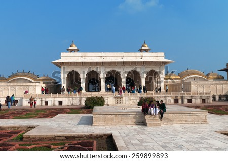 AGRA, INDIA - DEC 16, 2014: View of Anguri bagh and Khas Mahal in Red Agra Fort. Tourists walk and photographed in the garden
