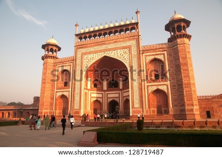 AGRA, INDIA - FEBRUARY 6: Tourists arrive at the entrance gate to Taj Mahal on February 6, 2011 in Agra. Taj Mahal was built by Mughal emperor Shah Jahan in memory of his third wife, Mumtaz Mahal.