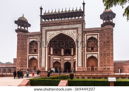 AGRA, INDIA - JAN 21, 2016: Gate to the Taj Mahal (Crown of Palaces), an ivory-white marble mausoleum on the bank of Yamuna in Agra. UNESCO World Heritage Site