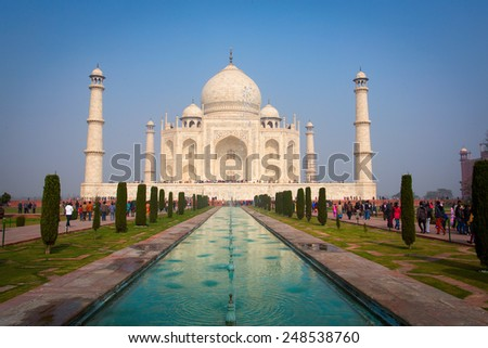 AGRA, INDIA - JAN 10: Taj Mahal Mousoleum in Agra on January 10, 2015. Taj Mahal was built by Mughal emperor Shah Jahan in memory of his third wife, Mumtaz Mahal. - stock photo